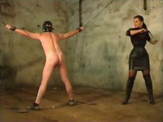 Brunette mistress is whipping her slave because