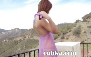 redhead woman teasing outdoors
