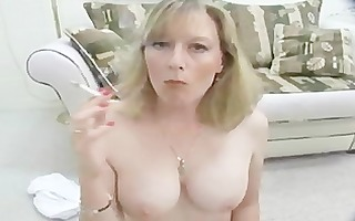 hot milf smokes topless for