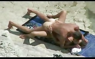 couple make sex on a nudism beach amador casal