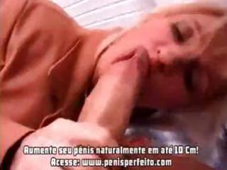 Busty mature blonde chick munches on two boners