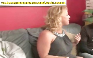 blond mommy goes down on his large dark jock and