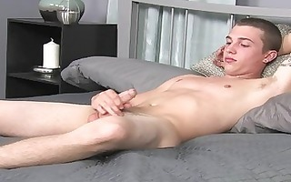 twink begins playing with his prick