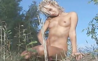 agreeable golden-haired chick in forest