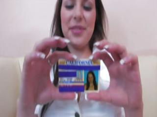 Young busty brunette shows her ID and then gives