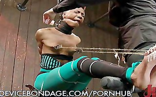 sexy swarthy babe locked up in bondage