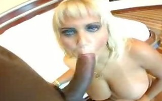 large titted blonde, a large dark dick and a good