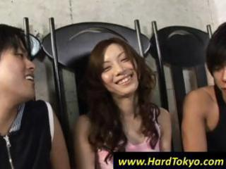 Cute Asian girl talks with two dudes who want a