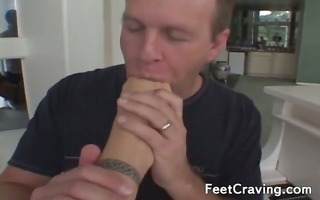 playgirl strokes a cock with her feet