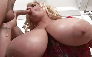 randy blond in red corset with greatly massive